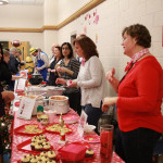 "Team #1: Christine Smith, Director of Student Services, Karen Cosgrove, Special Education Administrator, and Allyson Bell, Special Education Administrator. Serving: ""Perfect Pairs"" brie and fruit tart, pasta and meatballs, peanut butter and chocolate cupcakes."
